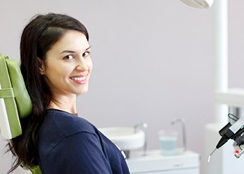 Woman smiling sitting in a dental chair